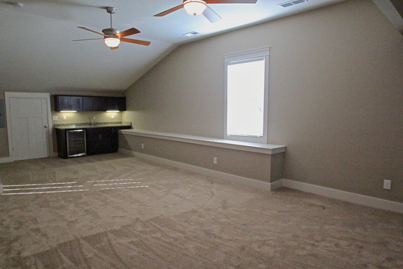 Upper Level Bonus Room With 2 Storage Areas, A Wet Bar And A Full Bath