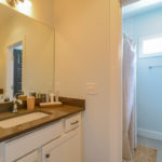 Close to the upstairs bedrooms and recreational room you will find this accommodating full bath.