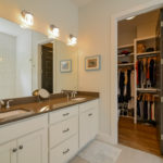 In the master glamor bath you will find double vanity and a glorious dream closet.
