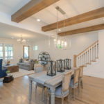 Beautiful wood beams span the dining area ceiling.