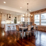 Look at this beautiful brick accent wall in the dining area.