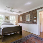 This room was built as a new addition in 2001 with the original brick wall.