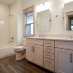 This is the shared bath. It also boasts double vanities.