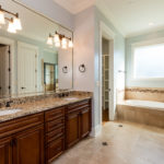 En suite master bath is spacious and luxurious.