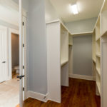 Huge walk in closet with great built ins for your entire wardrobe.