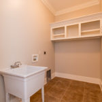 9x6 utility room with sink for your hand washables on main level.