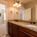 Jack & Jill bath between the 2nd & 3rd bedrooms has large vanity and great cabinet space