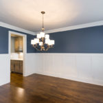 Architectural elements like this gorgeous wainscoting touch this home and give it charisma.