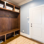 Mudroom cubbies to help tame the clutter as you enter the home from the 3 car garage.