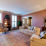 The formal sitting room has a gas fireplace & beautiful plantation shutters.