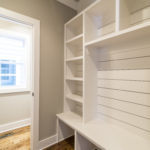 Built in cubbies will control the chaos of coming home--located just inside the interior garage door.