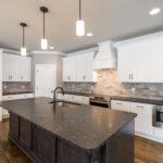 The kitchen, the heart of the home, with stainless appliances, granite countertops and lots of cabinet space.