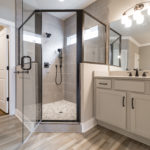 The en suite master bath with glass shower and walk in closet.
