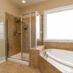 Large luxurious master bathrooms suite with garden tub and glass shower.