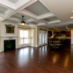 Coffered ceilings in your living room to enjoy as you spend time with family by the fire.