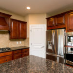 Stainless appliances and granite countertops with a nice size pantry complete this kitchen package.