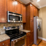 Beautiful kitchen space with gorgeous stainless steel appliances for the chef.