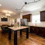 Lots of cabinet space along with a handy granite kitchen island with plenty of space to sit around.