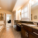 Beautiful master bath with double vanities and granite counters.