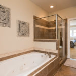 Jetted tub and glass shower round out your oasis from the busy world.
