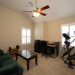 The third bedroom is tucked on the back of the house. Used as an exercise room for this owner.