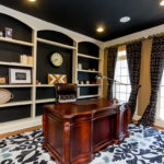 Home office with great built in shelves for your books and photos.