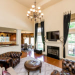 Elegant two story ceiling in the living room with gas fireplace makes this a great gathering spot for your family.
