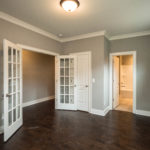 Located at the front of the house, this room with french doors can be used as a bedroom, office or library or even a music room.