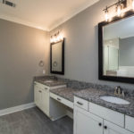 Master bath has lovely granite countertops, double vanity and hung mirrors.