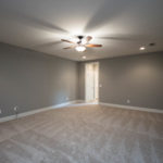 Upstairs is a spacious rec room with carpet.