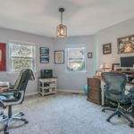 The 3rd bedroom is spacious and used as a home office for this family.