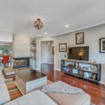 Imagine your sweet family spending quality time together in this charming living room.