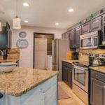 Enjoy granite countertops and stainless steel appliances in your new kitchen!