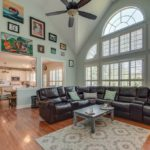 This lovely living room includes fireplace and great space for entertaining.