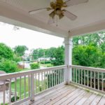 This amazing covered balcony is enjoyed by access thru the master bedroom
