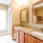 The double vanities and granite countertops make your master bath everything you want it to be. Separate garden tub and glass shower are included as well in your personal oasis from the world.