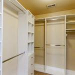 Awesome master closet with plenty of room for all your wardrobe - his and hers!