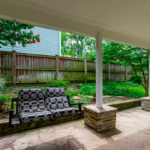 Covered porch with plenty of space to spread out and completely fenced & private.