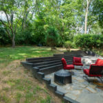The stone patio will be perfect for entertaining friends & neighbors.