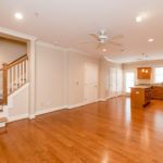 Gleaming hardwoods downstairs along with utility closet and half bath.