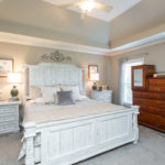 Heading upstairs, the master bedroom is a true oasis from the busy world.