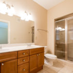 Master bath has glass shower and great lighting!