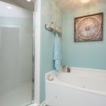 Jetted tub and glass shower in this spa-like bathroom