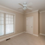 2nd bedroom on upper level with plenty of natural light or close the blinds for complete privacy.
