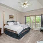 The master bedroom has trey ceilings and neutral colors to complement your furniture.