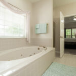 The jetted tub and glass shower complete your master suite oasis from the hustle and bustle of the world.