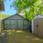 Storage buildings are located toward back of property and convey with home. Aggregate driveway provides off-street parking for at least 2 vehicles.