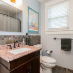 Renovated (except for original medicine cabinet and porcelain tub) full bath has granite vanity, new fixtures, new toilet and slate tile.
