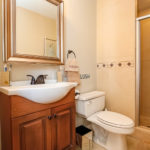 The in-suite bath has nice finishes and a glass shower.