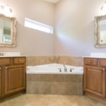 Enjoy the luxury of having master bath featuring a double vanity, a detached soaking tub and a separate shower.